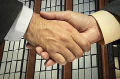 two businessmen shaking hands 5188623575 s